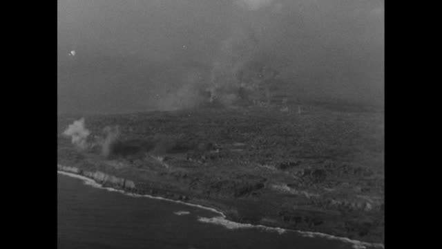 aerial shot of smoke rising from island during battle of iwo jima - battle of iwo jima stock videos & royalty-free footage