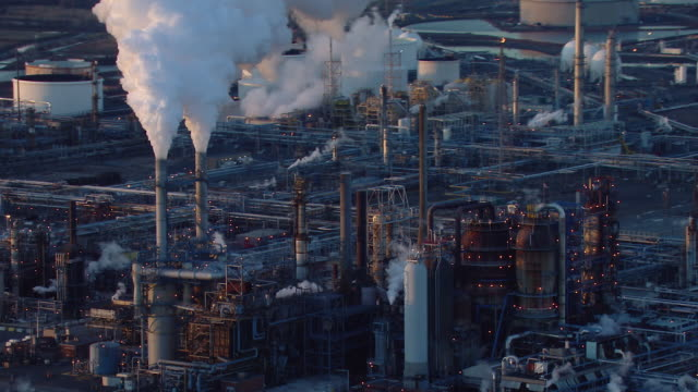 aerial shot of smokestacks emitting steam or smoke at a new jersey oil refinery. - chimney stock videos and b-roll footage