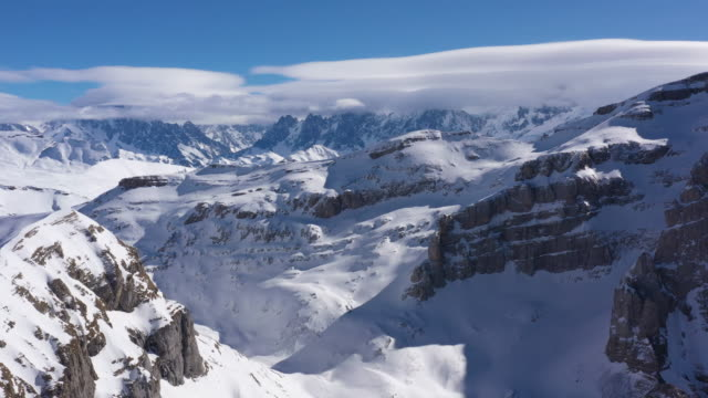 aerial shot of snow covered grand massif and mont blanc - mont blanc stock videos & royalty-free footage