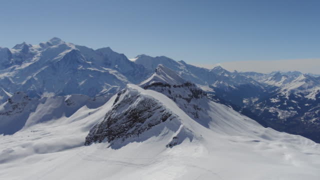 aerial shot of snow covered rocks of mont blanc - snowcapped mountain stock videos & royalty-free footage