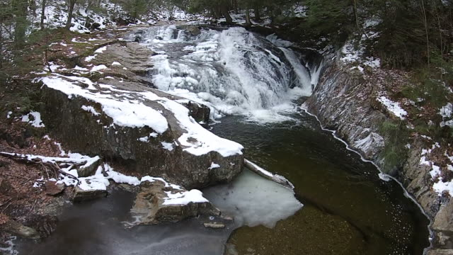 aerial shot of snowy water fall - vermont stock-videos und b-roll-filmmaterial