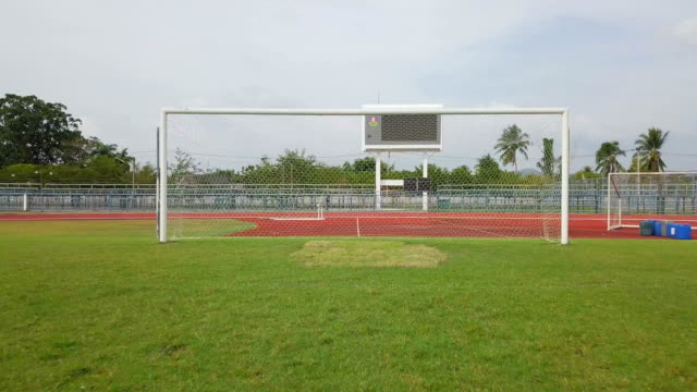 aerial shot of soccer field and soccer goal in thailand - hitting stock videos & royalty-free footage
