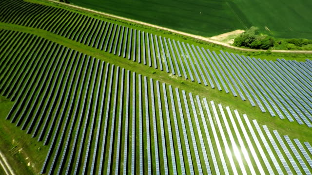aerial shot of solar power station - solar power station stock videos and b-roll footage