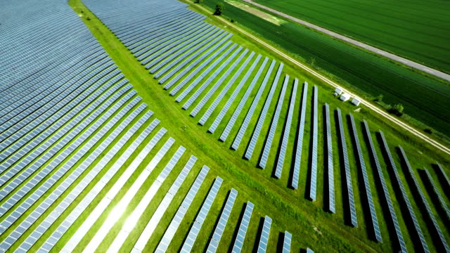 aerial shot of solar power station - solar panels stock videos & royalty-free footage