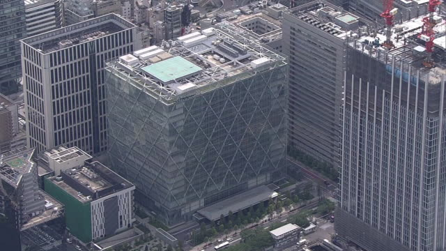 aerial shot of sony corporation's headquarters complex, a building in which sony's headquarters and sony group are located; sony is a world leading... - sony stock-videos und b-roll-filmmaterial