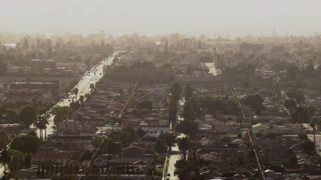 Aerial shot of South Los Angeles neighborhood, backlit.