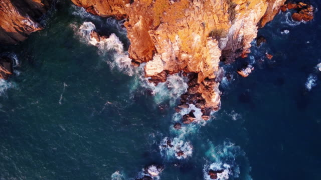 4k aerial shot of spectacular cliffs on northern oregon coast - rock formation stock videos & royalty-free footage