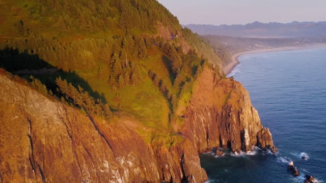 4k aerial shot of spectacular cliffs on northern oregon coast - oregon coast stock videos and b-roll footage