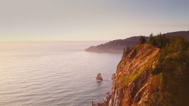 4k aerial shot of spectacular cliffs on northern oregon coast - cliff stock videos & royalty-free footage