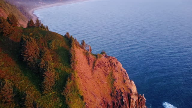 4k aerial shot of spectacular cliffs on northern oregon coast - stack rock stock videos and b-roll footage