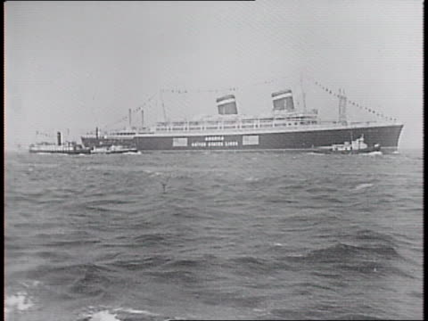 Aerial shot of SS America in New York Harbor then as seen from the water / interior of ship of skipper and crewman