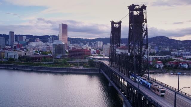 aerial shot of steel bridge and downtown portland, oregon - portland oregon bildbanksvideor och videomaterial från bakom kulisserna