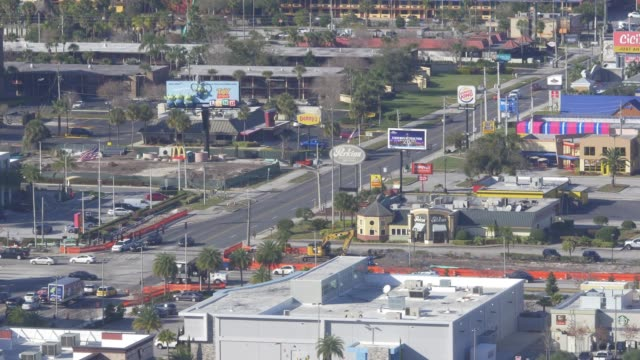aerial shot of stores and traffic in orlando, florida - orlando florida stock videos & royalty-free footage