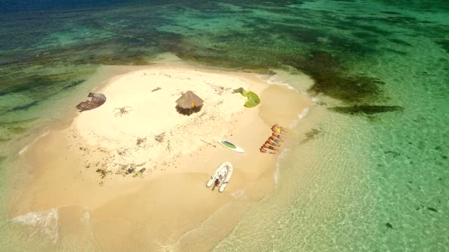 aerial shot of stranded kitesurfers in the caribbean - water sport stock videos and b-roll footage