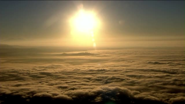 aerial shot of sun above clouds on october 21, 2013 in los angeles, california - elevated view stock videos & royalty-free footage