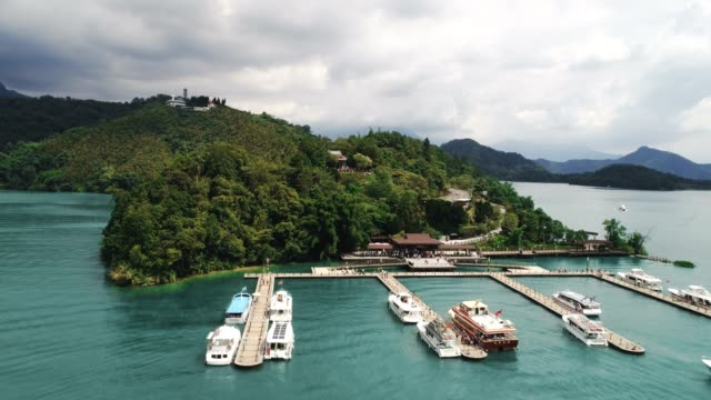 aerial shot of sun moon lake from lalu island to xuanguang temple pier, taiwan - sun moon lake stock videos and b-roll footage
