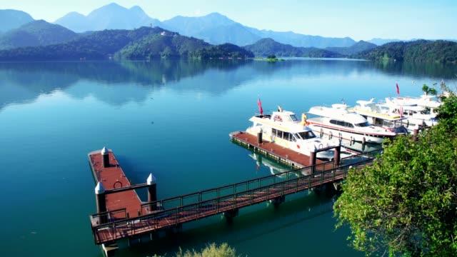 aerial shot of sun moon lake in shuishe pier, taiwan - sun moon lake stock videos and b-roll footage