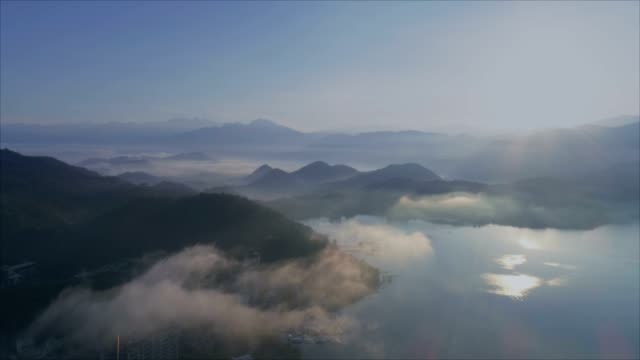 aerial shot of sun moon lake with floating clouds, taiwan - taiwan stock videos and b-roll footage