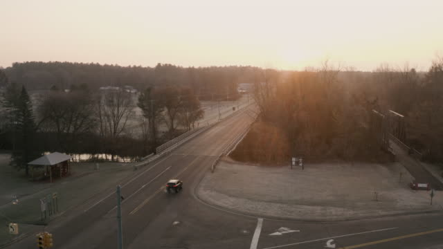 aerial shot of sunrise over main street in midwest america - rural scene stock videos & royalty-free footage