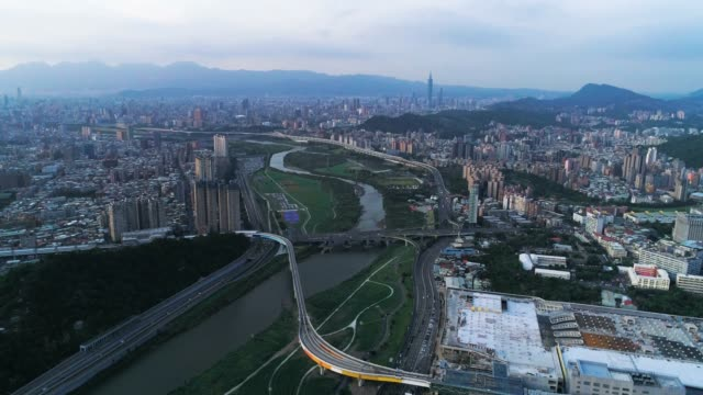 Aerial shot of Taipei City with beautiful reflections of skyscrapers and bridges/=