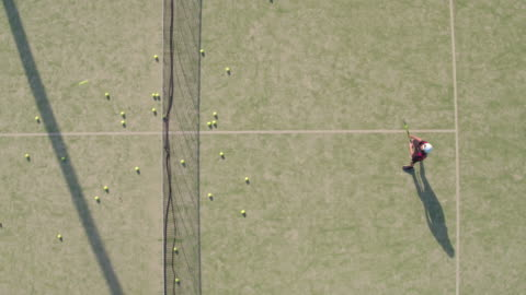 aerial shot of teenager practicing tennis - sports court stock videos & royalty-free footage