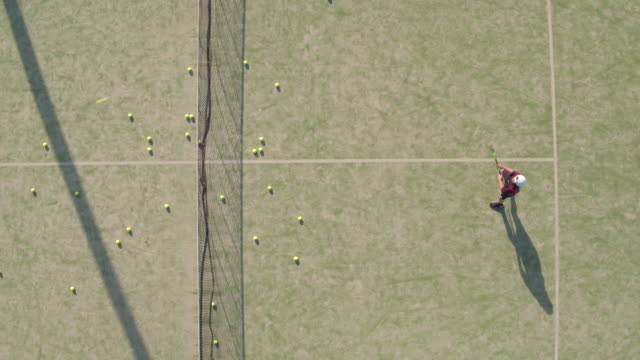 aerial shot of teenager practicing tennis - tennis stock videos & royalty-free footage