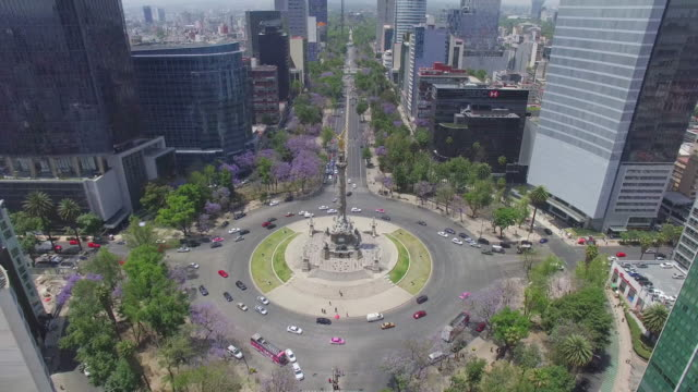 aerial shot of the angel de la independencia and reforma avenue in mexico city - avenue stock videos & royalty-free footage