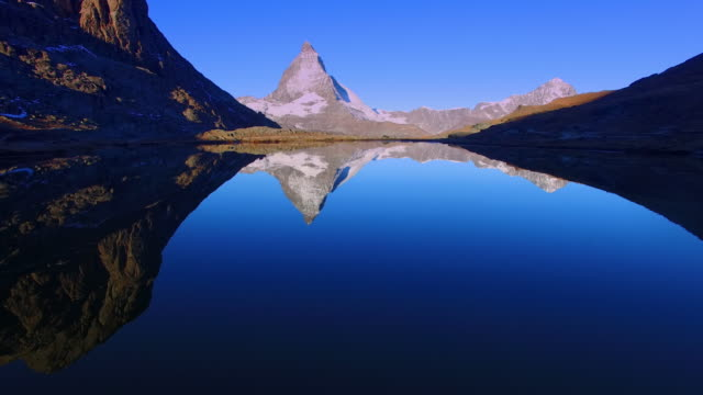 aerial shot of the beautiful matterhorn - lake stock videos & royalty-free footage