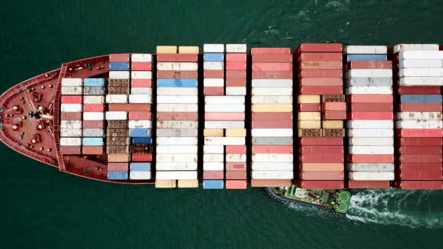 aerial shot of the cargo ship moving through the sea. - container stock videos & royalty-free footage