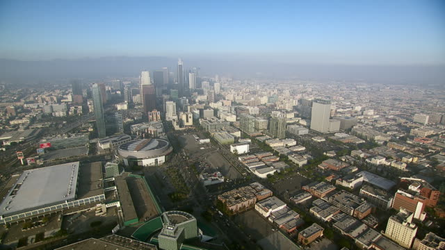 aerial shot of the city of los angeles in southern california. - staples centre stock videos & royalty-free footage