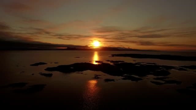aerial shot of the coast line on the west coast of scotland during sunsey near arisaig with rum and eigg in the background - twilight stock videos & royalty-free footage