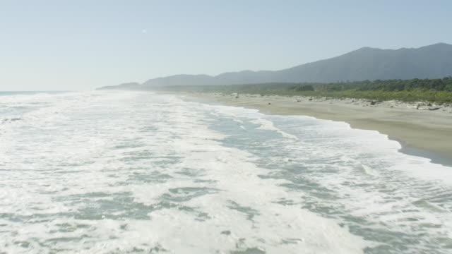 aerial shot of the coastline in haast - coastline stock videos & royalty-free footage