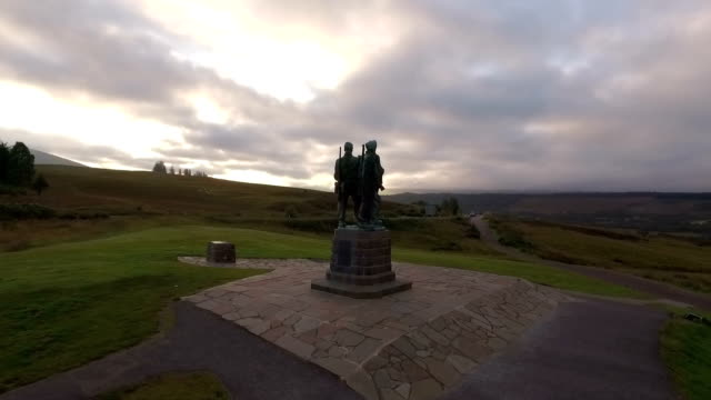 aerial shot of the commando memorial at spean bridge in the scottish highlands - male likeness stock videos & royalty-free footage