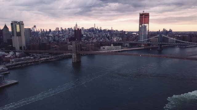 Aerial shot of The East River and New York City skyline on an autumn morning