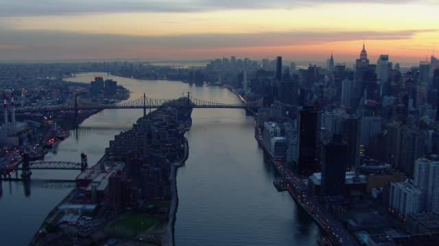 Aerial shot of the East River and the Queensboro Bridge in New York City.