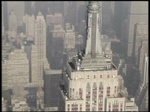 aerial shot of the empire state building in manhattan new york city new york empire state building aerial new york city on january 01 2012 in new... - salmini stock videos & royalty-free footage