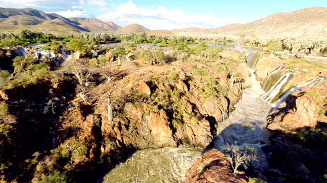 heli aerial shot of the epupa falls - multicopter stock videos & royalty-free footage