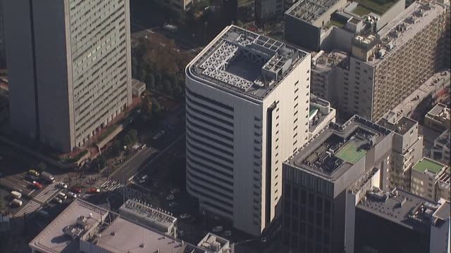 aerial shot of the head office of honda motor co., ltd., one of the world's largest motorcycle and automobile manufacturers - personal land vehicle stock videos & royalty-free footage
