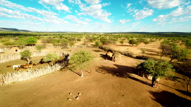 heli aerial shot of the himba settlement - remote location stock videos and b-roll footage