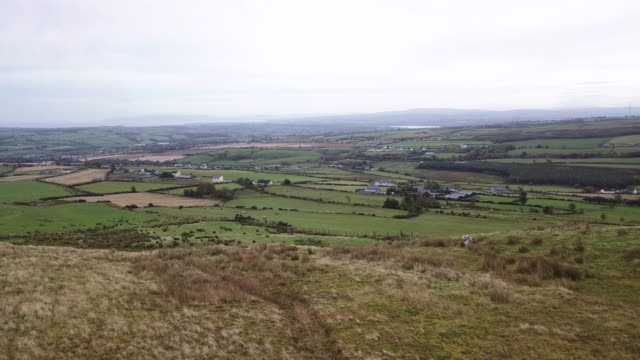 aerial shot of the irish countryside on a stormy afternoon. - ulster province stock videos & royalty-free footage