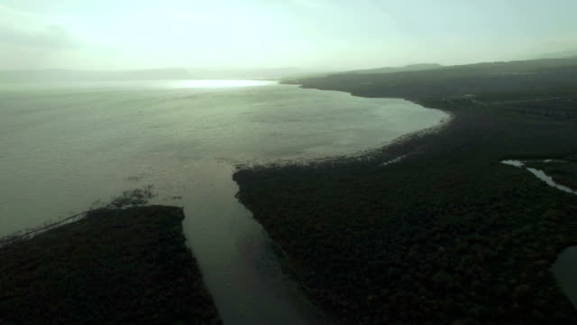 Aerial shot of the Jordan River flowing to the Sea of Galilee, Israel