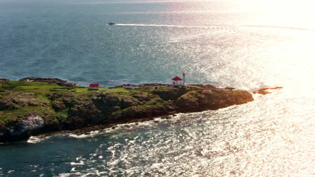 Aerial shot of the lighthouse on Trial island in sunshine