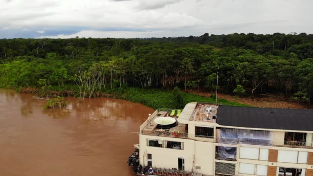 aerial shot of the luxury riverboat and the amazon forest and river, amazon, peru, south america - riverbank stock videos & royalty-free footage
