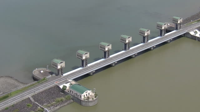 aerial shot of the north tide gate of isahaya bay on the ariake sea built by the government's reclamation project - ariake sea stock videos and b-roll footage