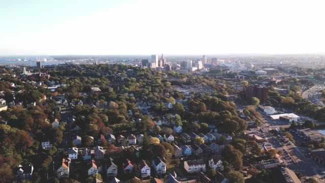 vidéos et rushes de aerial shot of the outskirts of providence, rhode island at sunset - rhode island