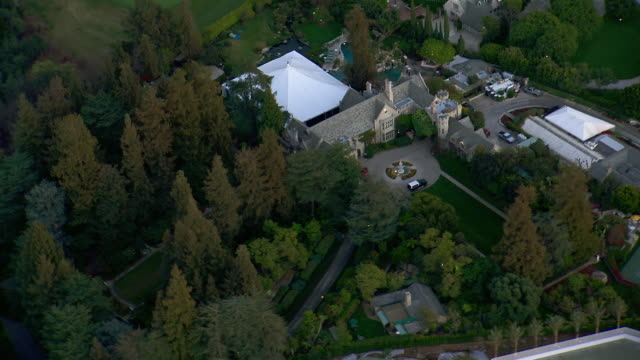 los angeles, california - march 1, 2012: aerial shot of the playboy mansion, home of hugh hefner, in los angeles california. - westwood neighborhood los angeles stock videos & royalty-free footage