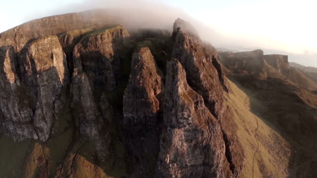 Aerial shot of the Quairang in Skye (Scotland) with morning light revealing dramatic landscape of the Needle