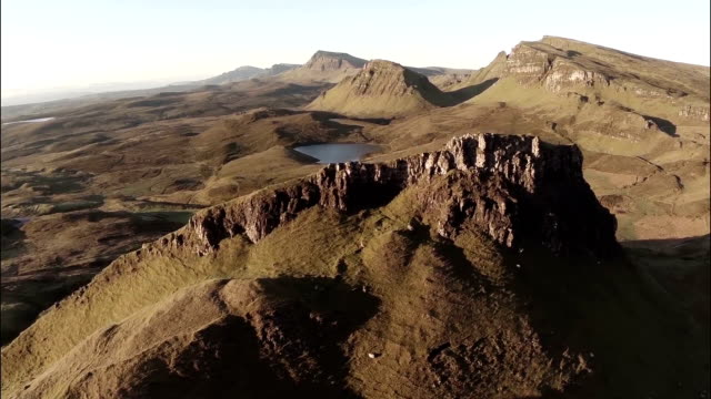 Aerial shot of the Quairang in Skye (Scotland) with morning light revealing dramatic landscape