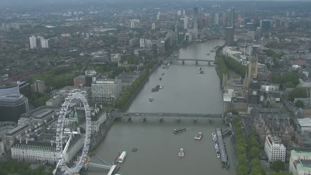 aerial shot of the river thames travelling passed the cocacola london eye towards fulham london england - overhead view stock videos & royalty-free footage
