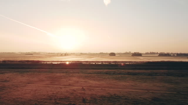 aerial shot of the rural dutch countryside with fog at sunrise, netherlands - オランダ文化点の映像素材/bロール